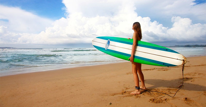 female surfer on beach