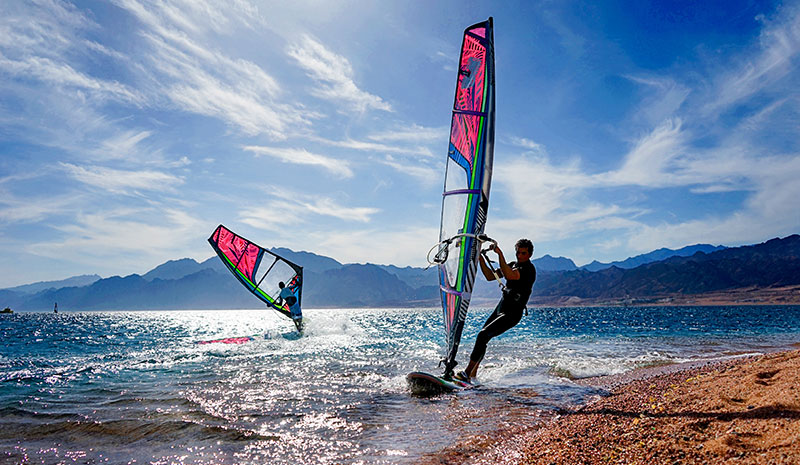 two guys wind surfing