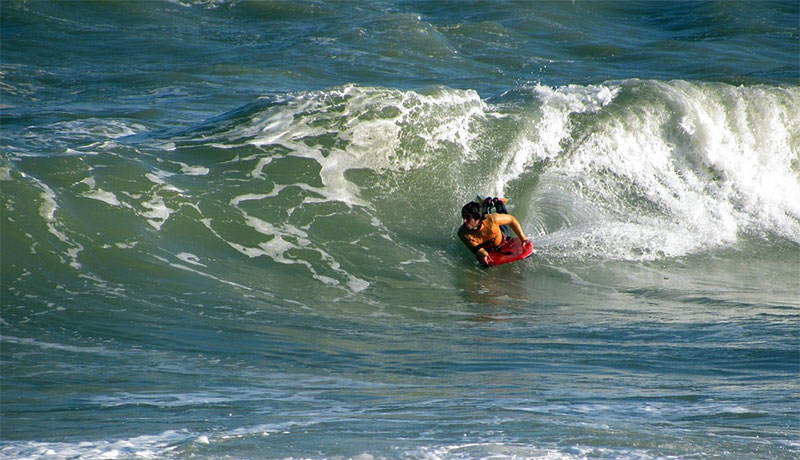 bodyboarding in the waves