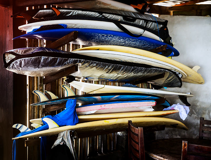 bunch of surfboards on rack